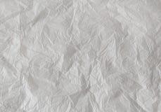Abstrakter Hintergrund - weißes zerknittertes Papier. Lizenzfreie Stockfotos