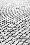Abstrakter Kopfsteinsteinhintergrund Stockfotos