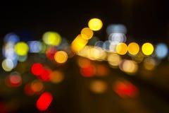 Abstrakter Kreis-bokeh Hintergrund der Straße in Bangkok von Thailand Lizenzfreie Stockfotos