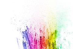 Abstrakter mehrfarbiger Staub spritzen auf weißen Hintergrund stockfotografie