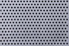 Abstrakter Metallloch-Hintergrund Lizenzfreies Stockfoto