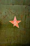 Abstrakter militärischer grüner Hintergrund mit rotem Stern. Stockbild