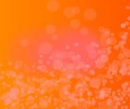 Abstrakter orange Hintergrund mit Partikel .orange backgraound. Lizenzfreies Stockfoto