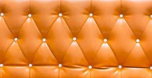 Abstrakter orange lederner Sofahintergrund, lederner Hintergrund, Lizenzfreie Stockfotografie