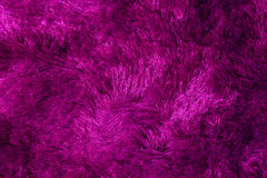 Abstrakter purpurroter Teppich auf dem Boden Stockbild