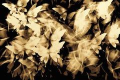 Abstrakter romantischer Hintergrundgoldschmetterling auf Schwarzem Stockfotografie