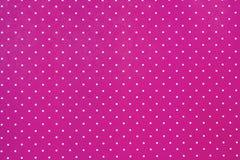Abstrakter rosafarbener Hintergrund mit weißen Punkten stockfoto