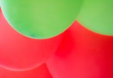 Abstrakter roter und grüner Ballonhintergrund Stockfotografie