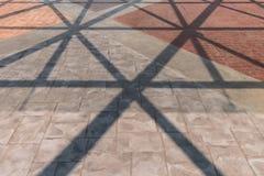 Abstrakter Schatten auf pavemen Stockfoto