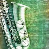 Abstrakter Schmutzhintergrund mit Saxophon Stockbilder