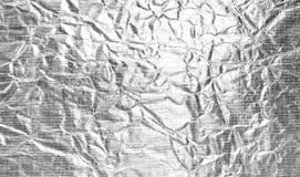 Abstrakter silberner Aluminiumfoliehintergrund Stockbilder
