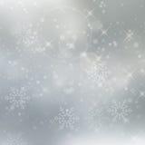 Abstrakter silberner Winterhintergrund mit Schneeflocken Lizenzfreies Stockfoto