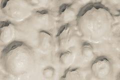Abstrakter strukturierter holperiger Hintergrund einer beige Oberflächenfarbe Lizenzfreie Stockfotos