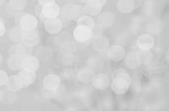 Abstrakter Unschärfehintergrund: Schönes graues Bokeh Lizenzfreies Stockbild