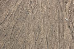 Abstrakter unscharfer Hintergrund mit grauem Sand stockbild