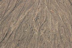 Abstrakter unscharfer Hintergrund mit grauem Sand lizenzfreies stockfoto
