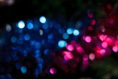 Abstrakter Weihnachtshintergrund. Feiertag farbige Lichter Stockbild
