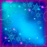 Abstrakter Weihnachtshintergrund mit den blauen und weißen Schneeflocken Lizenzfreie Stockfotos