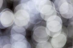 Abstraktes Bild des weißen bokeh von der Beleuchtung Stockfoto