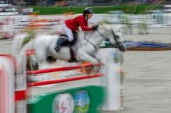 Abstraktes Bild mit einem Pferd am Showspringen Stockbild