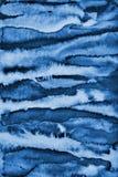Abstraktes blaues Aquarell auf Papierbeschaffenheit als Hintergrund Christm Lizenzfreies Stockfoto