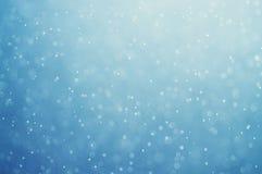 Abstraktes blaues bokeh defocused Hintergrund Stockfoto