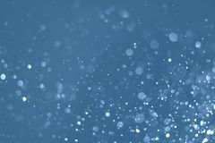 Abstraktes Blaulicht bokeh defocused Hintergrund Stockfotografie
