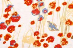Abstraktes Blumenmuster auf weißem Gewebe Stockbilder