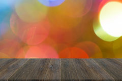 Abstraktes bokeh des Lichtes mit hölzerner Terrasse Lizenzfreie Stockbilder