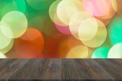 Abstraktes bokeh des Lichtes mit hölzerner Terrasse Stockbilder