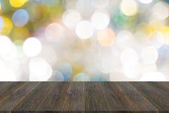 Abstraktes bokeh des Lichtes mit hölzerner Terrasse Lizenzfreie Stockfotos