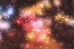 Abstraktes Bokeh-Licht auf dunklem Hintergrund stockbilder