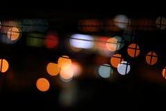 Abstraktes bokeh Licht im dunklen Hintergrund Lizenzfreies Stockbild