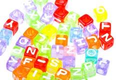 Abstraktes buntes Alphabet blockt Hintergrund Lizenzfreie Stockfotos