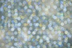 Abstraktes buntes Bokeh kreist Weihnachtshintergrund ein Stockbild