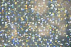 Abstraktes buntes Bokeh kreist Weihnachtshintergrund ein Stockbilder