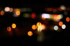 Abstraktes buntes bokeh Licht auf Nachthintergrund Lizenzfreie Stockfotografie