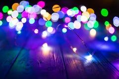 Abstraktes buntes Bokeh-Licht im Nachthintergrund Stockfotografie