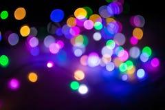 Abstraktes buntes Bokeh-Licht im Nachthintergrund Lizenzfreie Stockbilder