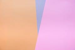 Abstraktes buntes Hintergrundfarbpapier in der Dreieckform Stockfotografie