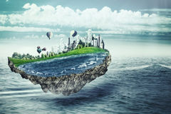 Abstraktes eco und Klimakonzept Eco-Konzept mit fantastischer Insel Lizenzfreies Stockfoto