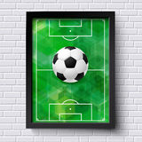 Abstraktes Fußballplakat Bildrahmen auf weißer Backsteinmauer mit foo Stockbild