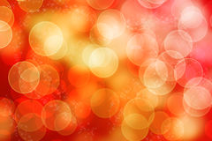 Abstraktes glänzendes bokeh roter gelber Hintergrund Stockfotografie