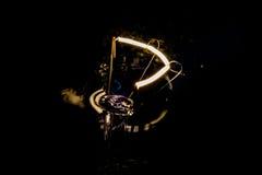 Abstraktes Glühen einer Glühlampe Makro Stockfotos