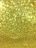 Abstraktes Gold-bokeh kreist für Weihnachtshintergrund, Funkelnli ein Stockfoto