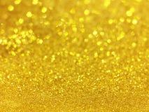 Abstraktes Gold-bokeh kreist für Weihnachtshintergrund, Funkelnli ein Lizenzfreie Stockbilder