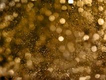 Abstraktes Gold Bokeh kreist Hintergrund ein Gold unscharfer Hintergrund, Stockbilder