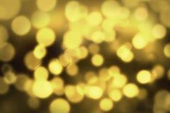 Abstraktes Gold- Kreis-bokeh Hintergrund Stockfoto