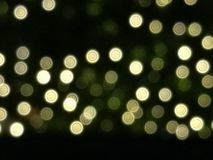 Abstraktes Gold- und gelbes Licht bokeh Hintergrundisolat auf schwarzem Hintergrund, Licht nachts, Valentinsgruß, neuem Jahr, Ost Stockfotos