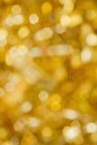 Abstraktes Gold unscharfe Lichter Lizenzfreie Stockfotografie
